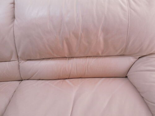 I have tried a few things to wash the stain off too no avail  Please help. How can I get rid of a red pillow stain on a white leather couch