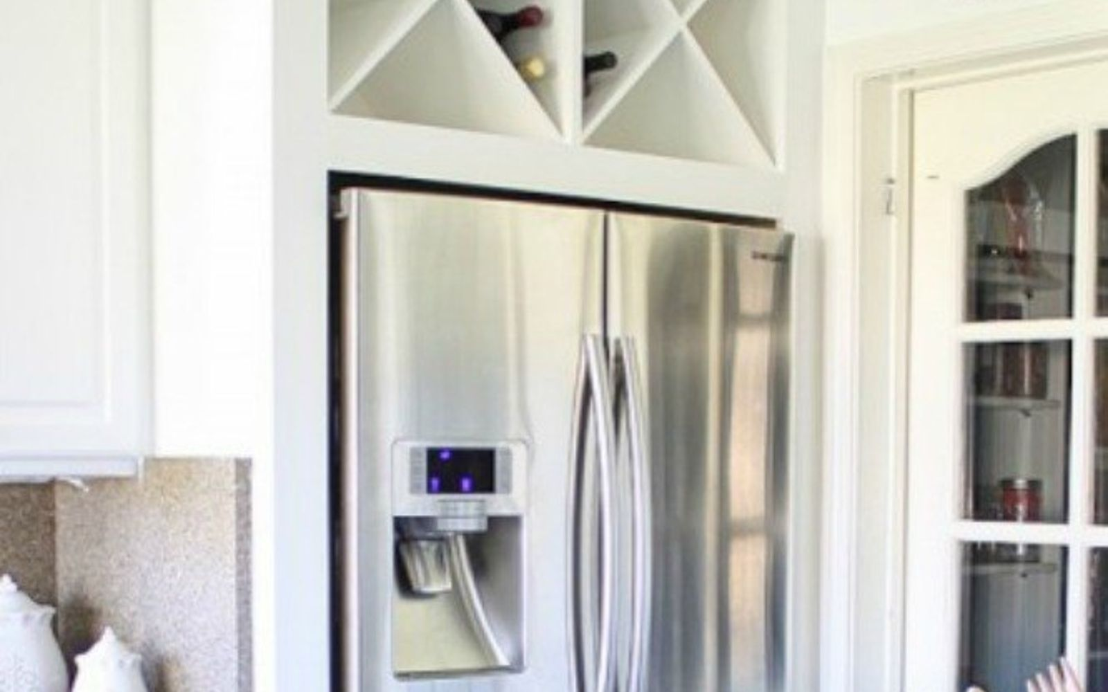 open fridge in kitchen. place open shelving above your fridge in kitchen