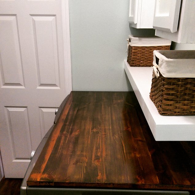 transform your laundry room floor with faux wood vinyl flooring hometalk. Black Bedroom Furniture Sets. Home Design Ideas