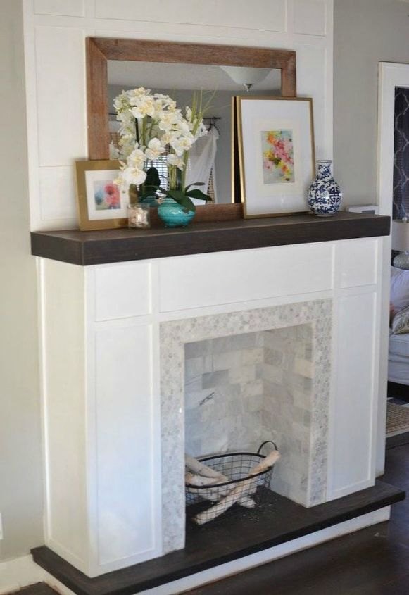 s 13 incredible living room updates using leftover wood, Build a faux built in fireplace