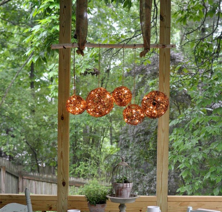 s 11 gorgeous backyard ideas you need to save for spring, Hang a rustic grapevine luminary