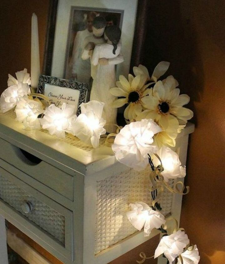 s 14 amazing fairy light ideas we re definitely going to copy, This flowery decor for your console table