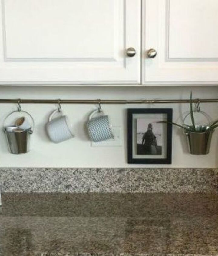 s organize your kitchen with these 16 simple and cheap storage ideas, kitchen design, organizing, storage ideas, Keep clutter off your counter with a rod