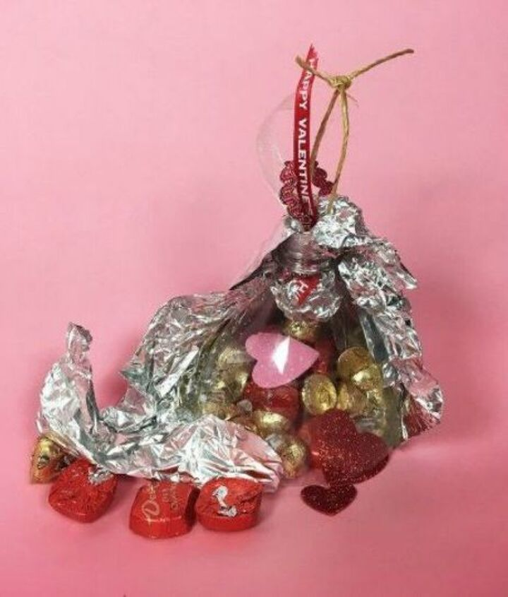s 20 heartfelt valentine s day gifts for under 20, seasonal holiday decor, valentines day ideas, Hang up big kisses filled with chocolate