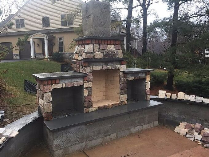installing stone veneer on outdoor fireplace, concrete masonry, fireplaces mantels, woodworking projects