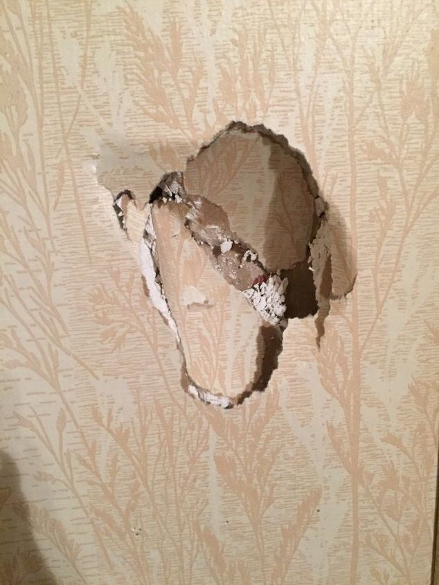 q how do i cover a hole on a wallpapered wall
