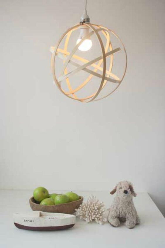 s 15 ultimate ways to use embroidery hoops in your home decor, home decor, Upcycle it into a modern orb light fixture