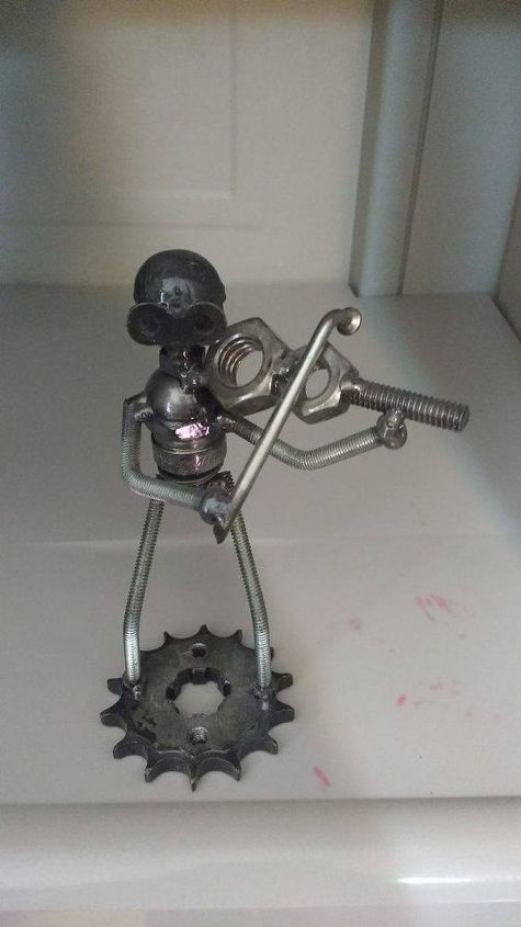 q feeling proud of my friend little statue made from nuts and bolts
