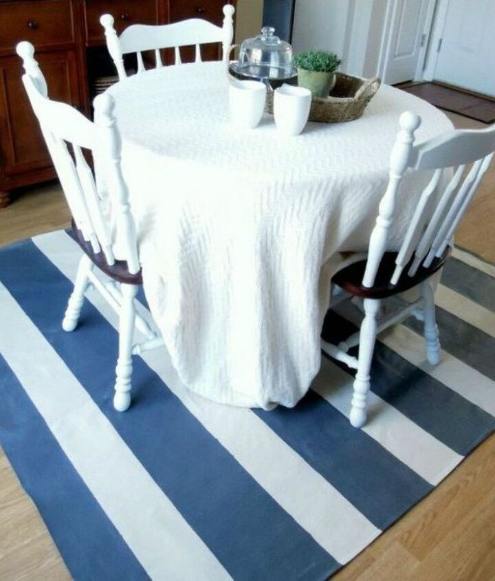s 11 ways you never thought of using fabric in your kitchen, kitchen design, reupholster, As a cute rug underneath your breakfast table