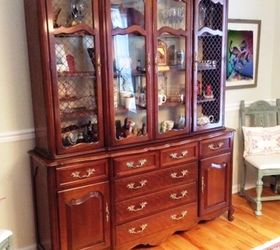 this is the china cabinet i want to paint all of the hardware comes off except the two handles in the middle that opens onto a writing desk and without