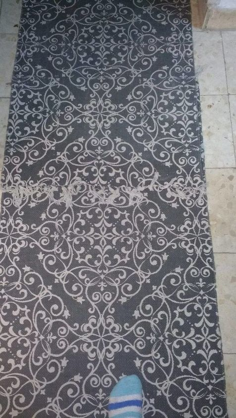 q how can i keep my hallway rug in place, foyer, reupholster