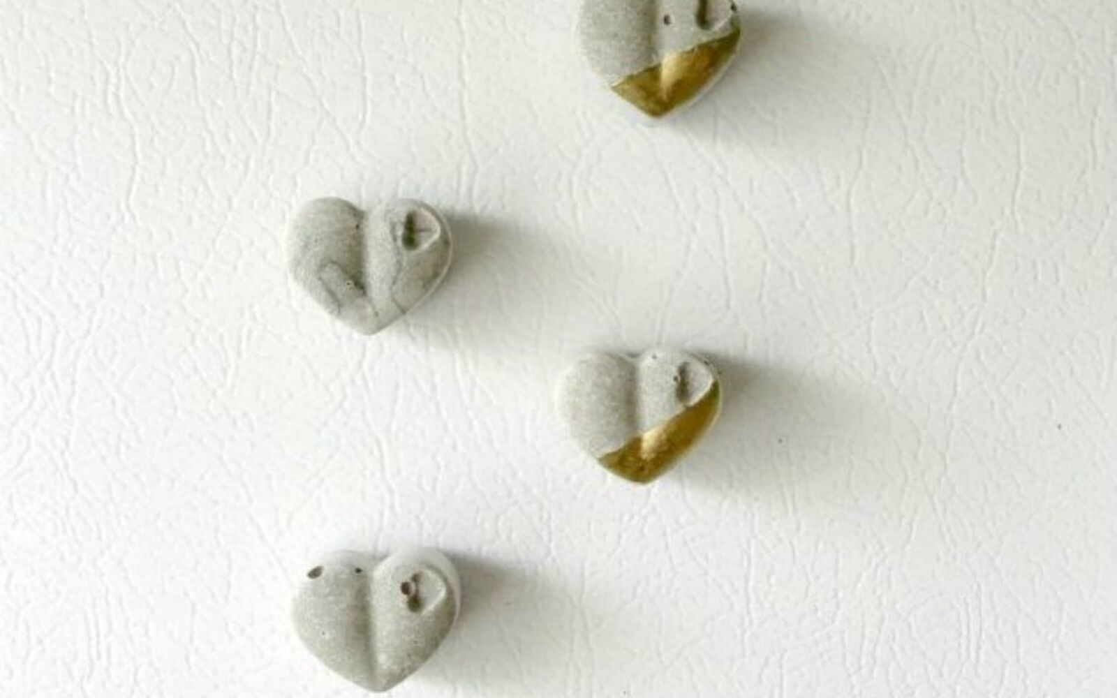 s 14 stunning ways to add cement to your home decor, concrete masonry, home decor, Mix it into heart shaped magnets
