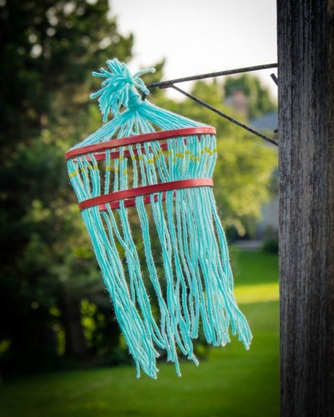 s yarn bomb your home with these 18 adorable ideas, home decor, String it into an outdoor tree hanger