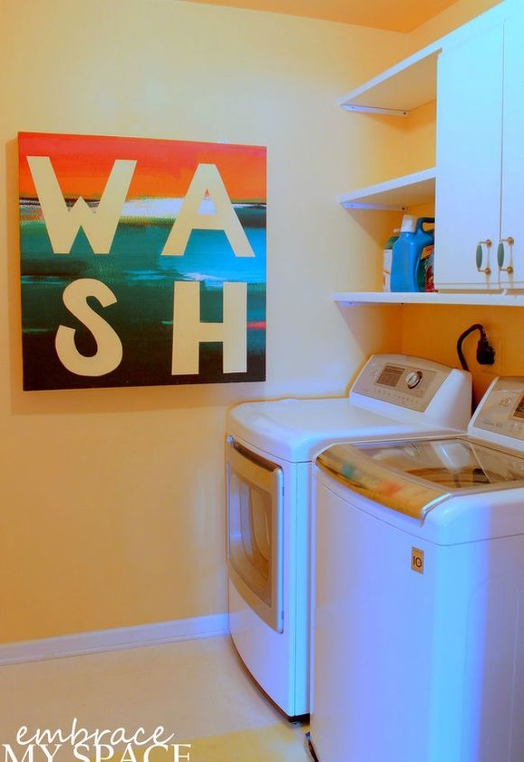 s 11 ways to update your dark and dingy laundry room for under 100, laundry rooms, Add some bright and colorful art