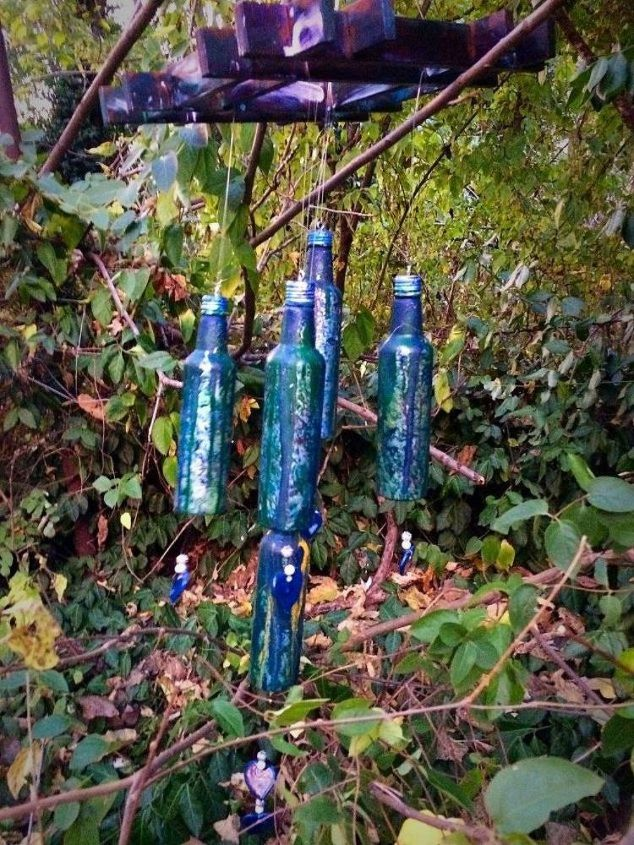 s reuse empty glass bottles for these 14 gorgeous decor ideas, home decor, Hang them up as the grooviest wind chimes