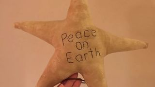 , Peace on Earth primitive Christmas tree topper