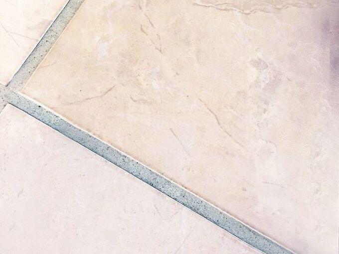 fix cracking grout bathroom floor