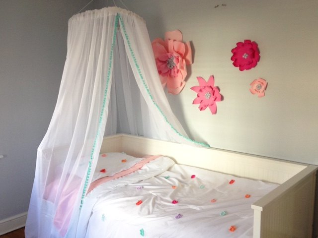 If you prefer, there are many options for crafting your own canopy bed curtains right at home such as this hula hoop canopy