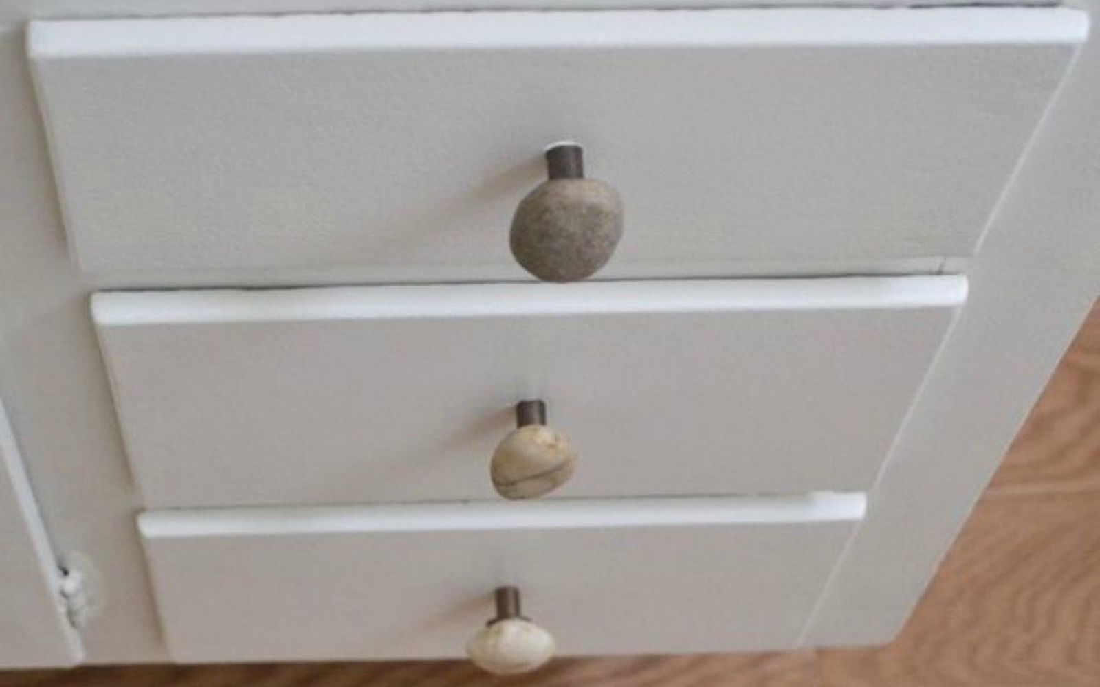 s 11 impressive ways to update your home with stone, concrete masonry, home decor, Replace your knobs with pretty pebbles