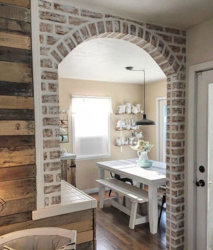 s 12 stunning ways to get that exposed brick look in your home, Grab a piece of lumber for a faux brick arch