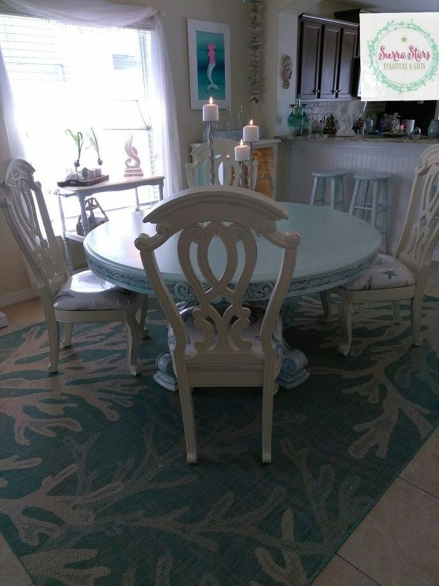 we used an old shower curtain to recover these old chairs