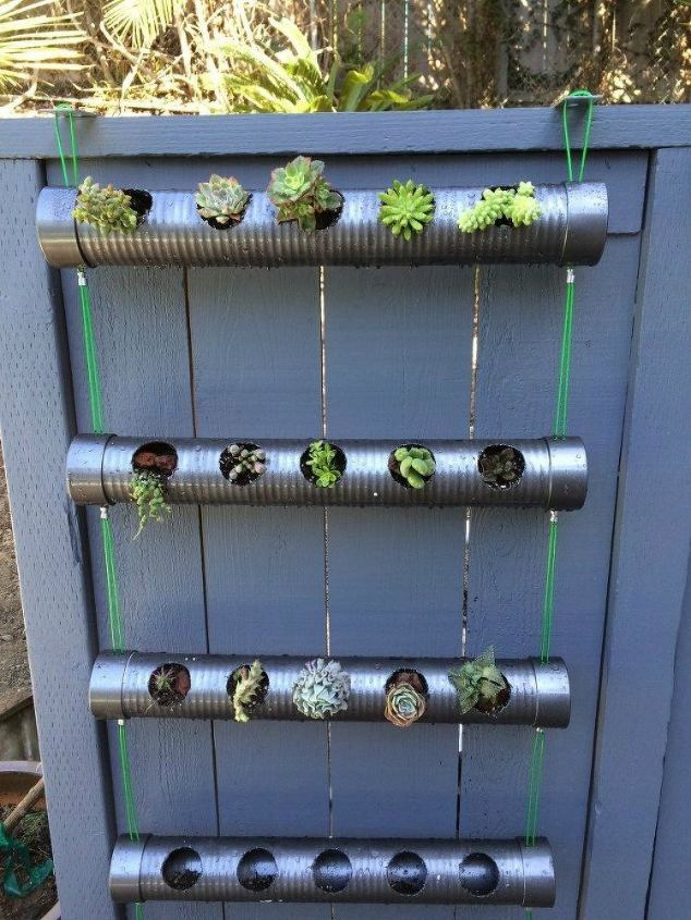 s the 15 coolest ways to reuse pipes in your home decor, Drill holes into them for a hanging planter