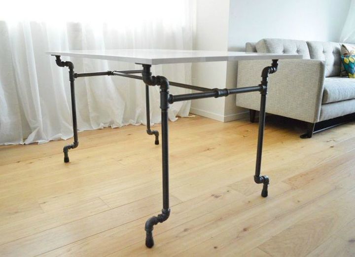 s the 15 coolest ways to reuse pipes in your home decor, Stabilize a table with industrial pipes