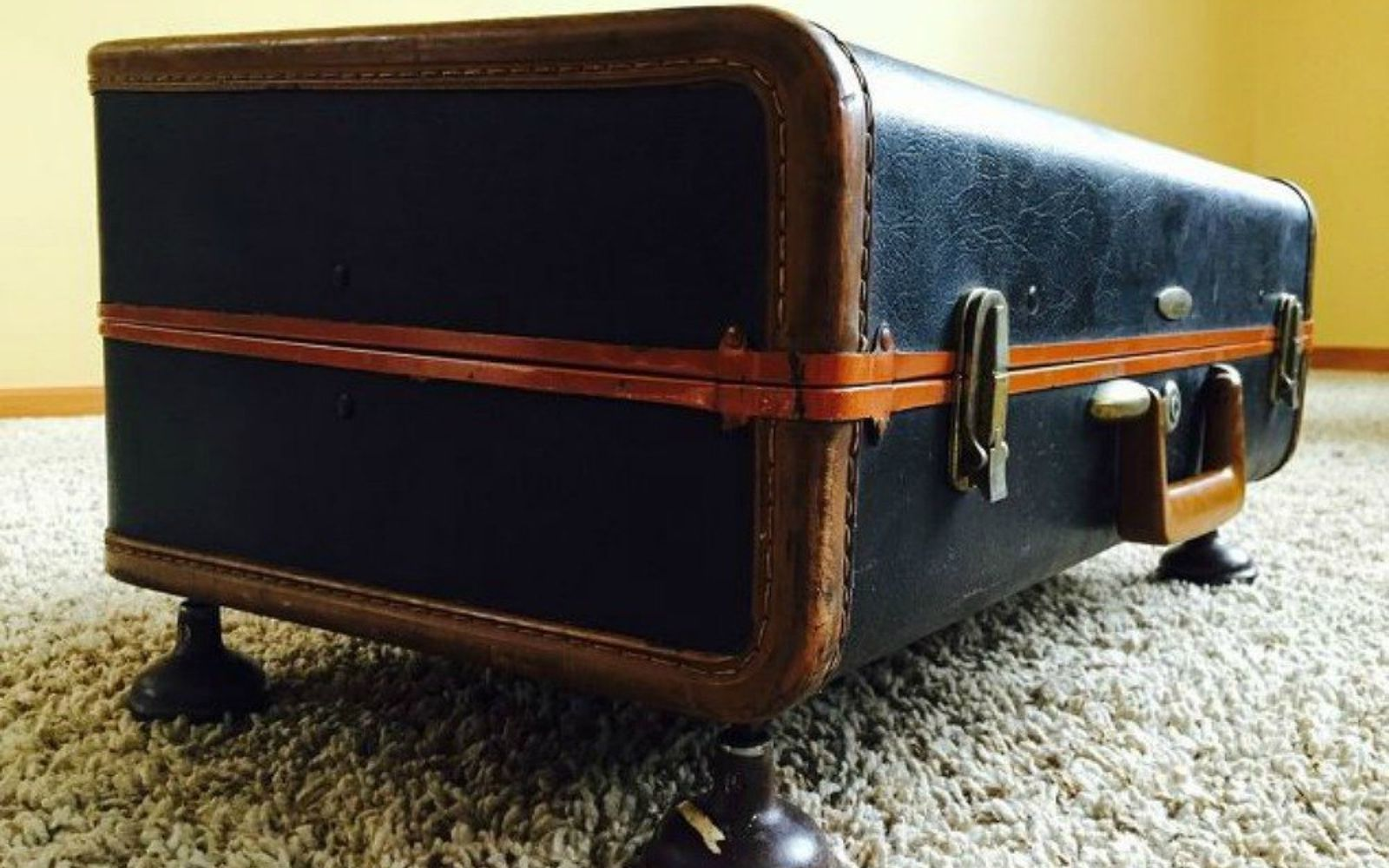 s don t throw out your old suitcase before you see these 15 clever ideas, Turn it into an adorable little ottoman