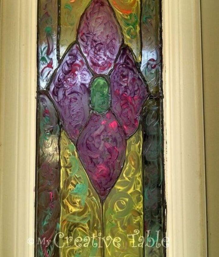 faux stained glass window with unicorn spit
