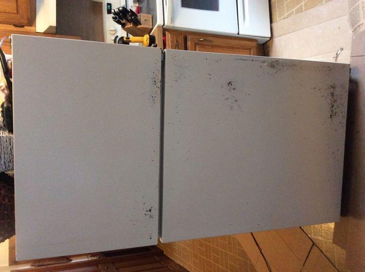 e painting a rusty fridge