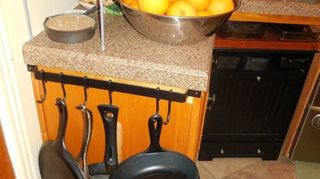 , New granite counter tops and a place to hang all Grandma s iron pans
