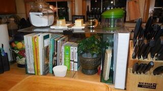 , Went to Tap Plastics and purchased this tower It fits perfect on the island and houses my cookbooks