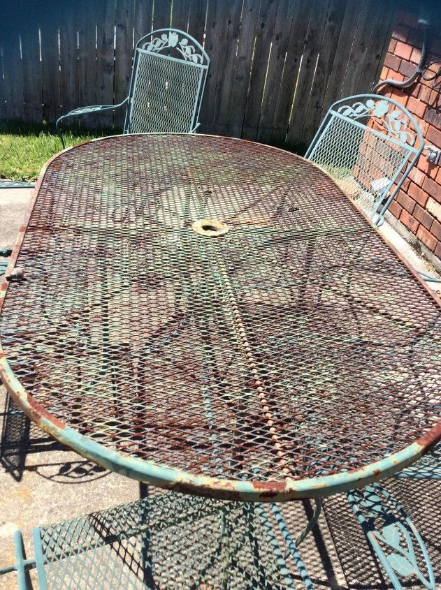 q what can i cover an oval outdoor rusty picnic table with