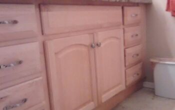 Can you re-paint/stain prefinished cabinets without sanding them?