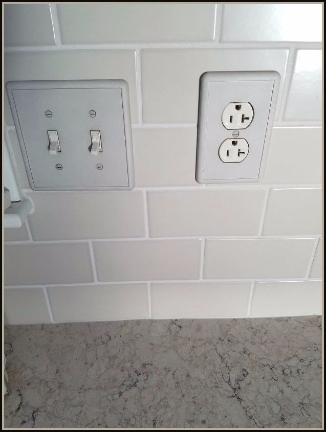 Detail of backsplash tile, switchplate covers