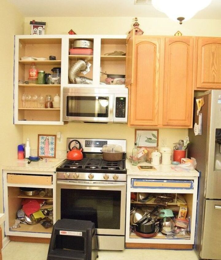 a kitchen with new white cabinets