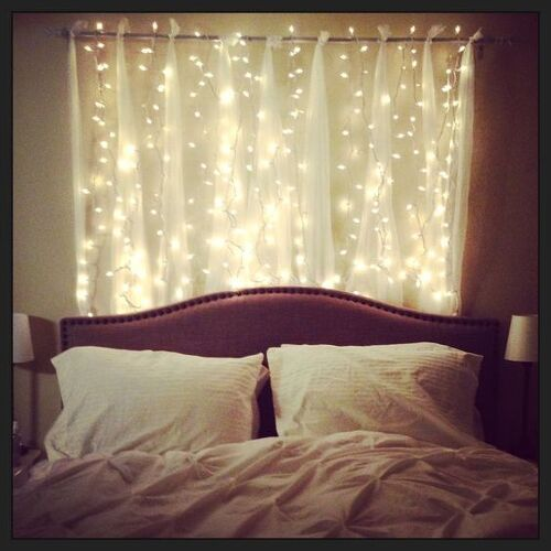 Get some string lights and hang them up behind a sheer shade i love this