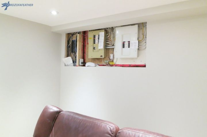 hiding an electrical panel in a finished basement