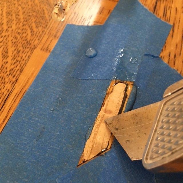 repair termite hole in hardwood floor