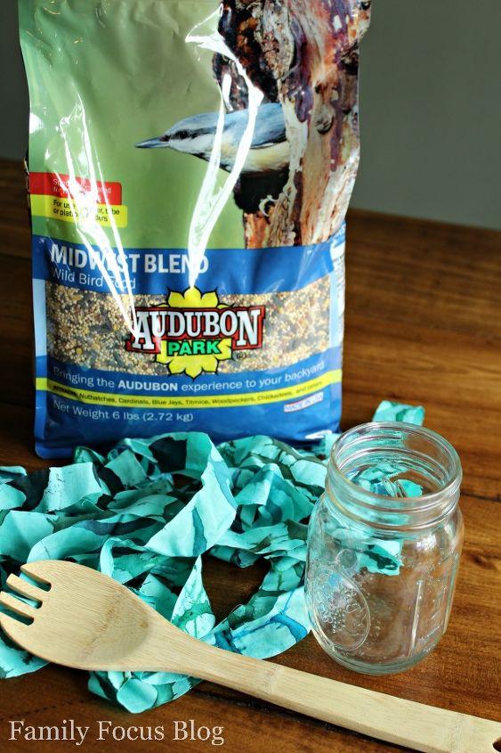 turn an old mason jar into a bird feeder