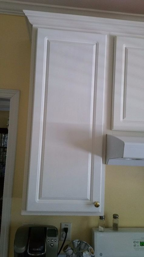 redoing my kitchen peeling cabinets one at a time