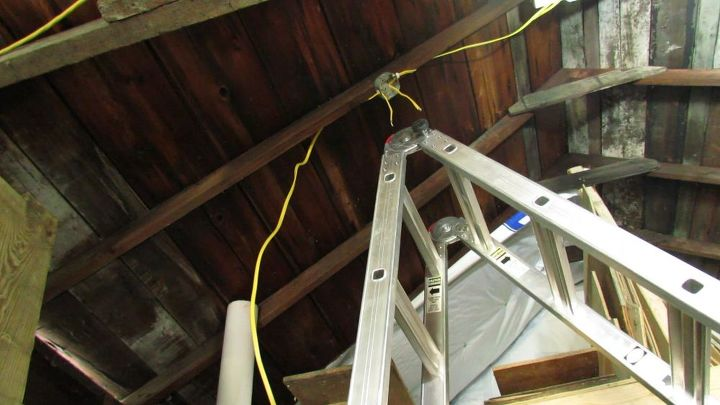 installing cheap hanging led lights to brighten a work space