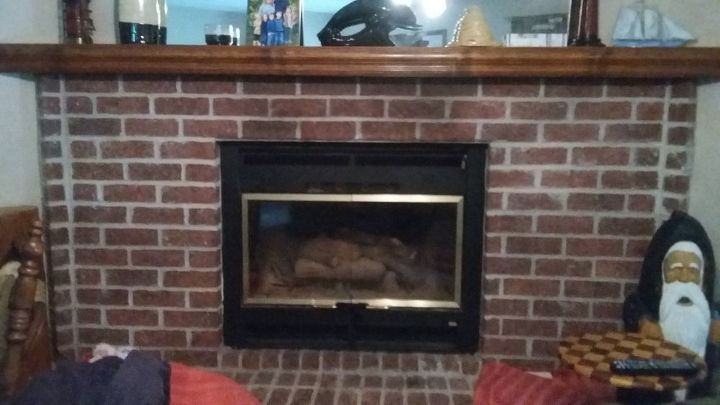 q i have a red brick fireplace that is way too large for the room wh