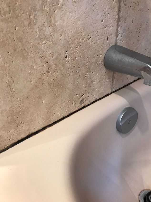 How do you clean bathroom caulking to remove black mildew