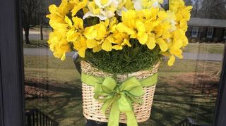 , I did the same with a thrift store basket and WalMart daffodils I just had a mama finch raise five babies in the back of it It was fun watching through my glass storm door
