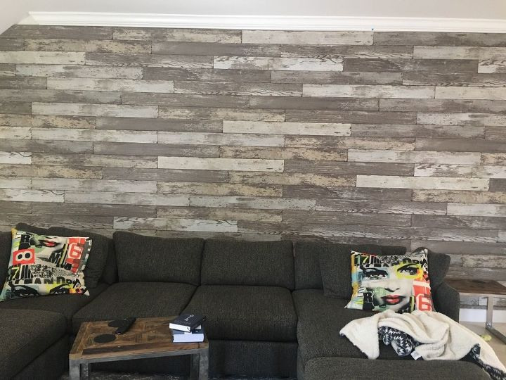 q any suggestions on how to decorate this large faux wood wall