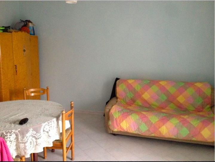Horrible, square room with horrible furniture