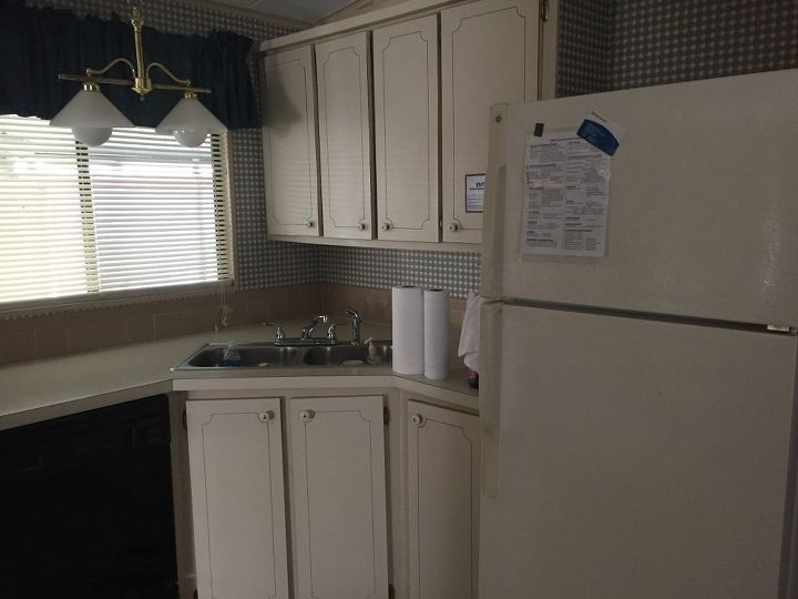q how do you successfully paint laminated cabinet doors