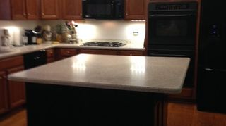 , hand rubbed Java finish on upper and lower cabinets island is new not re done