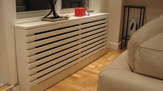 , This is a more modern take and as you can see under a window They made it the length of the area rather than just a cover over heater giving it a sleeker look